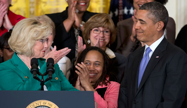 Women's rights activist Lilly Ledbetter, left, acknowledges President Barack Obama as she speaks in the East Room of the White House in Washington, Tuesday, April 8, 2014, during an event marking Equal Pay Day.
