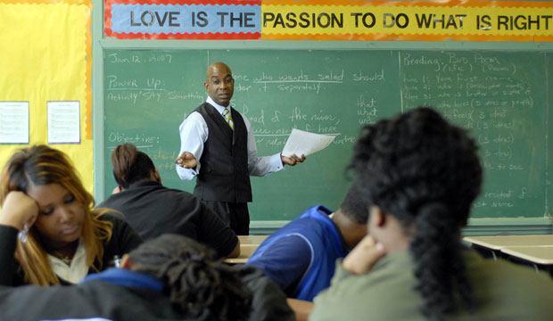 Norman Smith teaches language arts to students at a Louisiana Recovery School District high school in New Orleans