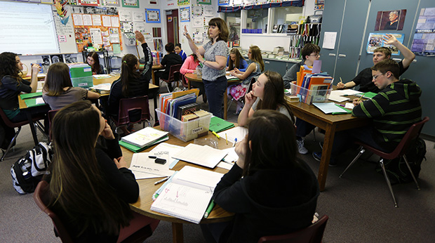 Annette Wells, center, takes questions in her seventh to eighth grade language arts class at Komachin Middle School in Lacey, Washington, April 18, 2014.