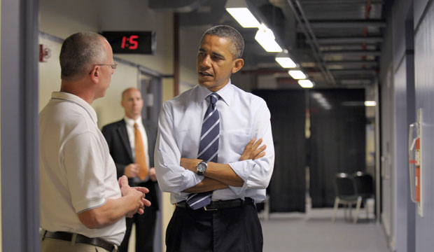 President Barack Obama talks with electrical apprenticeship instructor Tim Wisyanski during a visit to the International Brotherhood of Electrical Workers, or IBEW, Local No. 5 Training Center in Pittsburgh, Pennsylvania.