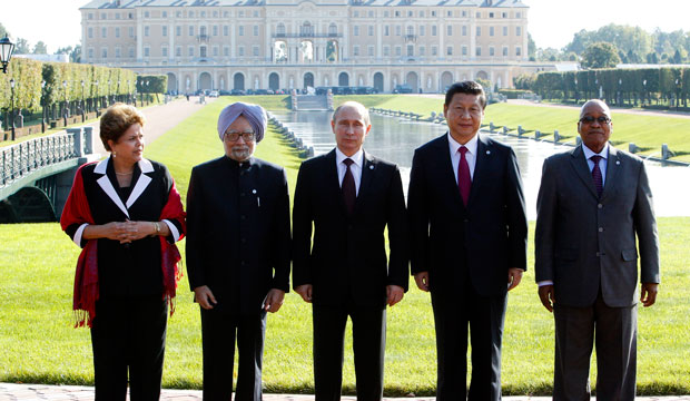 From left, Brazil's President Dilma Rousseff, India's former Prime Minister Manmohan Singh, Russia's President Vladimir Putin, China's President Xi Jinping, and South African President Jacob Zuma pose for a photo after a BRICS leaders' meeting at the September 2013 G-20 Summit in St. Petersburg, Russia.