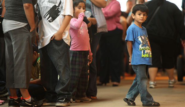 Children stand in line with some of the thousands of young immigrants at Chicago's Navy Pier.