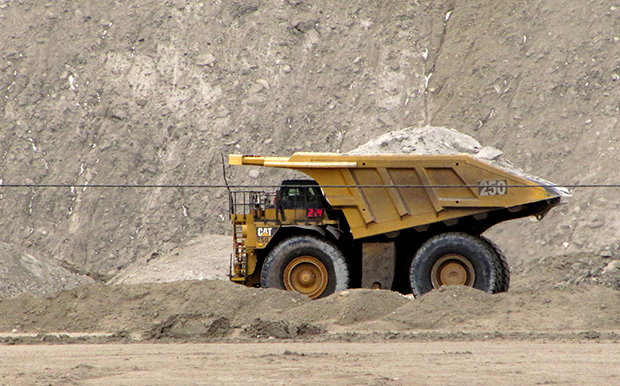 A house-sized dump truck hauls dirt and rock at the Black Thunder coal mine in northeast Wyoming's Powder River Basin near Wright, Wyoming.