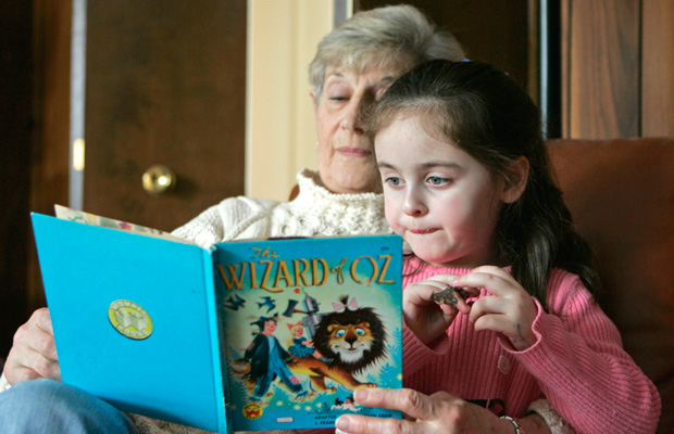 Mary Chaitoff reads to her great-granddaughter at Chaitoff's home in Pepper Pike, Ohio.