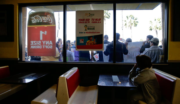 Demonstrators protest outside a McDonald's restaurant