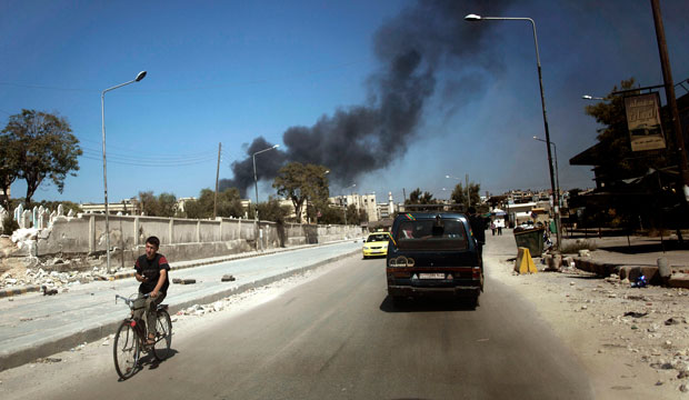 Black smoke leaps into the air from shelling by pro-Assad forces in a residential area in Aleppo, Syria.