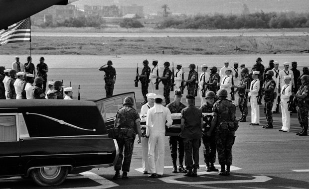 U.S. Marine and Navy pallbearers remove the coffin of one of the American staffers killed in the U.S. Embassy bomb blast in Beirut from a hearse on April 23, 1983.