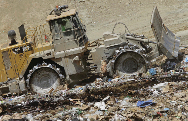 An earth mover buries waste at the Clinton Landfill near Clinton, Illinois.
