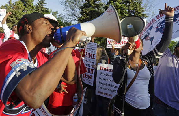 Protesters gather in Oak Brook, Illinois, to demonstrate for higher wages and the right to unionize.