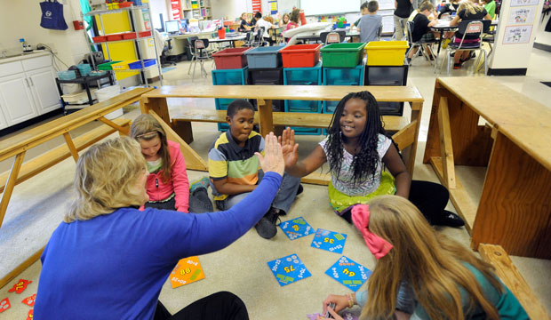 Third-grade teacher Sherry Frangia high-fives student Jayla Hopkins during a math lesson at Silver Lake Elementary School in Middletown, Delaware, in October 2013.