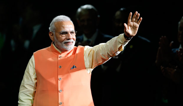 Indian Prime Minister Narendra Modi waves to the crowd as he arrives to give a speech at Madison Square Garden on September 28, 2014.