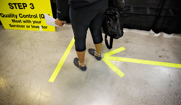 An arrow on the floor points the way for homeowners attempting to lower their monthly mortgage payment at a mortgage relief event in Atlanta, September 2014.