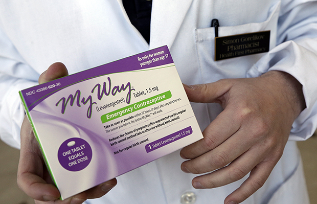 Pharmacist Simon Gorelikov holds a generic emergency contraceptive, also called the morning-after pill, at the Health First Pharmacy in Boston, Massachusetts, May 2, 2013.
