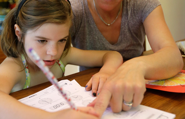Stacey Jacobson-Francis works on math homework with her 6-year-old daughter at their home in Berkeley, California.
