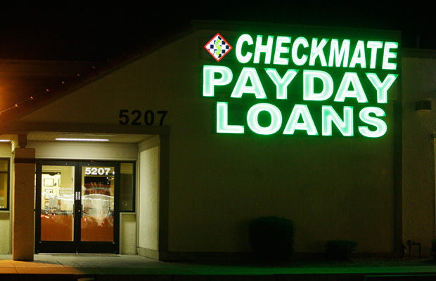 Neon signs illuminate a payday loan business in Phoenix, Arizona, in 2010.