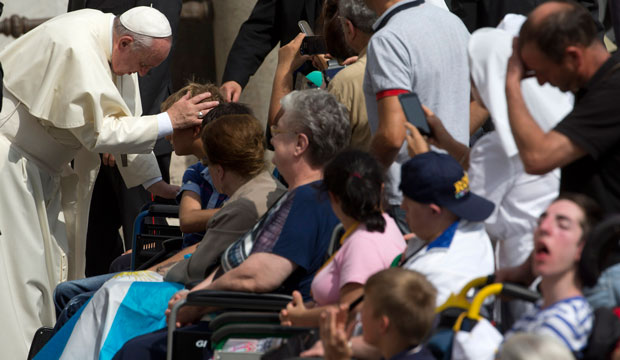 Pope Francis blesses sick people at the end of his weekly general audience in St. Peter's Square, September 10, 2014.