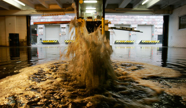 A sewer overflows as city pipes cannot hold the water brought by severe weather in Cleveland, Ohio.