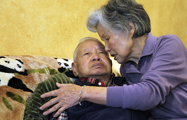 Shou-Mei Li, right, cares for her husband Hsien-Wen Li, who is an Alzheimer's patient, at their home in San Francisco, California, September 1, 2011.