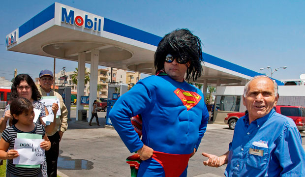 Demonstrator Norberto Gonzalez wears a Superman costume as he joins consumers to protest the high cost of gasoline in June 2008.