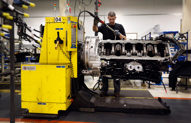 Jon Wyand works on a truck engine assembly line at Volvo Trucks' powertrain manufacturing facility in Hagerstown, Maryland.