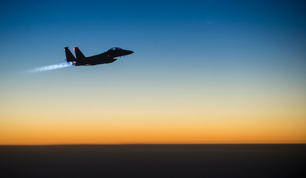 A U.S. F-15E Strike Eagle flies over northern Iraq after conducting airstrikes in Syria on September 23, 2014.