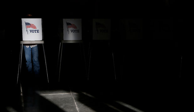 Voting booths are illuminated by sunlight as voters cast their ballots at a polling place in Billings, Montana.