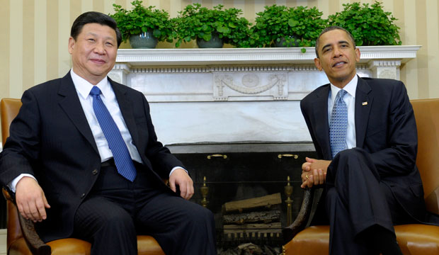 President Barack Obama meets with then-Chinese Vice President Xi Jinping in the Oval Office on February 14, 2012.