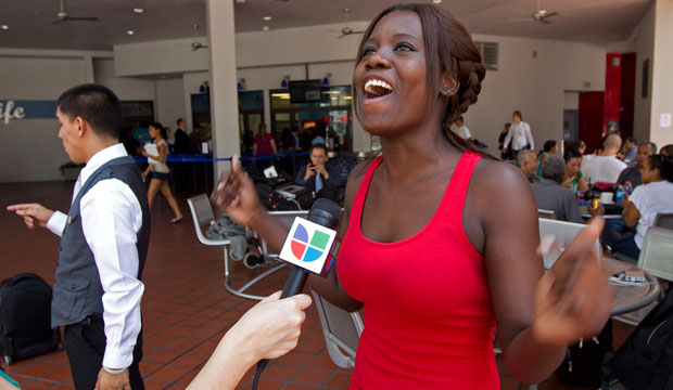 Niouseline St. Jean, an undocumented immigrant from Turks and Caicos Islands, talks to the media about the Deferred Action for Childhood Arrivals program in Miami, Florida.