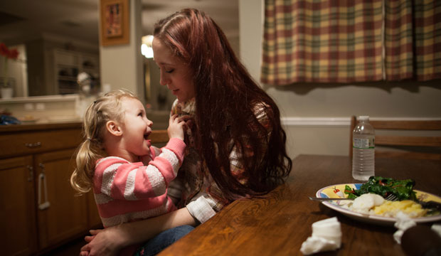 Maggie Barcellano sits with her daughter, Zoe, 3. Barcellano receives food stamps to help feed her daughter.