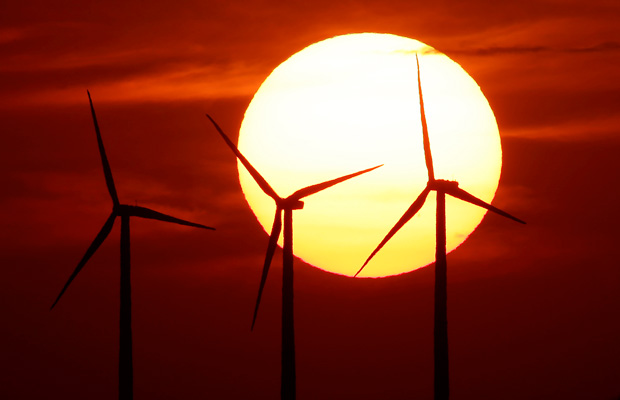 Wind turbines are silhouetted by the setting sun near Beaumont, Kansas.