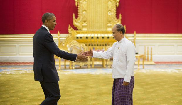 President Barack Obama reaches to shakes hands with Myanmar's President Thein Sein, Thursday, November 13, 2014, at in Naypyitaw, Myanmar.