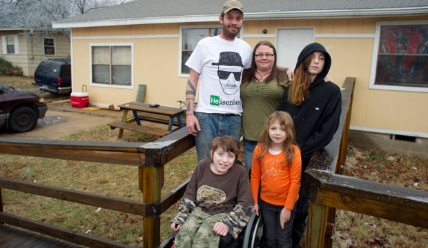 Lori Latch with her husband Chad; son Marcus, right rear; son Eric, front left; and daughter Ruby at their home in North Little Rock, Arkansas.