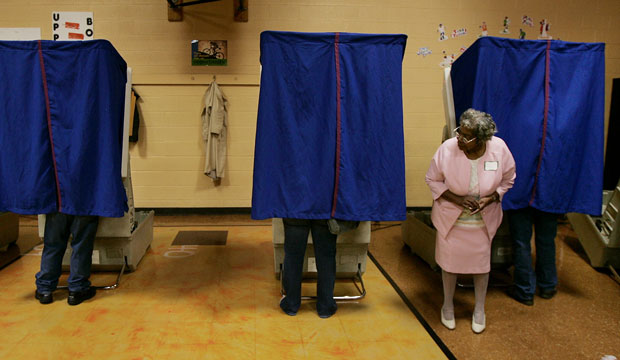 Poll volunteer Ethel Dunson waits for voters to finish casting their ballots in Columbus, Ohio.