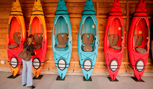 A shopper looks at a wall of kayaks at the L.L. Bean store at Ross Park Mall in Ross Township, Pennsylvania.