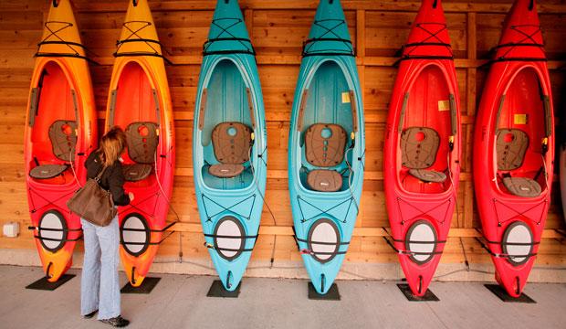 shopper looks at kayaks