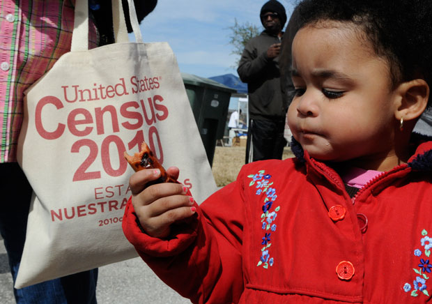 K'Treana Taylor, 2, eats a hot dog at a community resource fair in Galveston, Texas, to explain the importance of participating in the 2010 Census.
