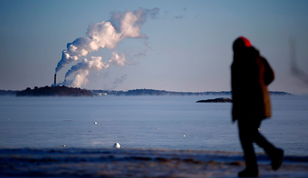 Plumes of steam blow from the Wyman Station power plant on Cousins Island in Yarmouth, Maine.