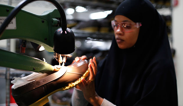 Muslima Hassan trims the rubber bottom of an L.L. Bean boot at a facility in Lewiston, Maine.
