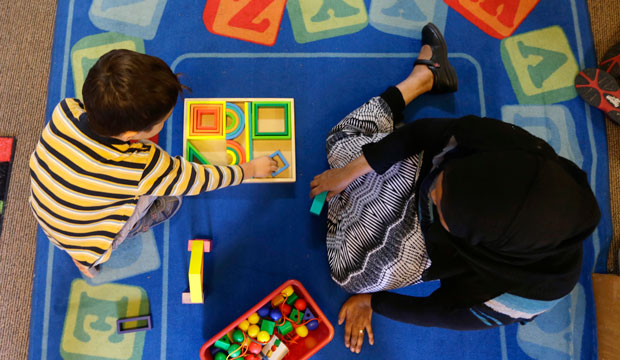 Declan Hart, 4, and teacher-in-training Deassi Usman play with shape blocks during a prekindergarten class at the Community Day Center for Children in Seattle.