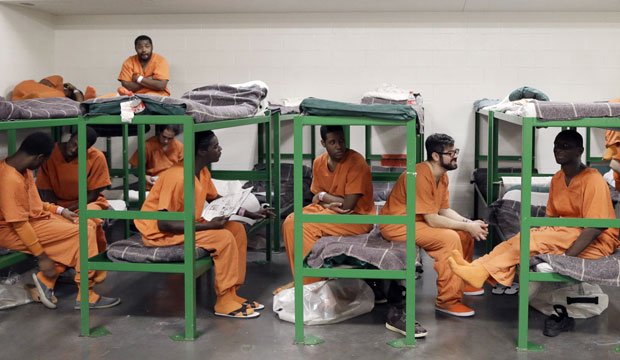 Inmates hang out on their bunks in a unit in the Harris County Jail for gay, bisexual, and transgender inmates in Houston, Texas.