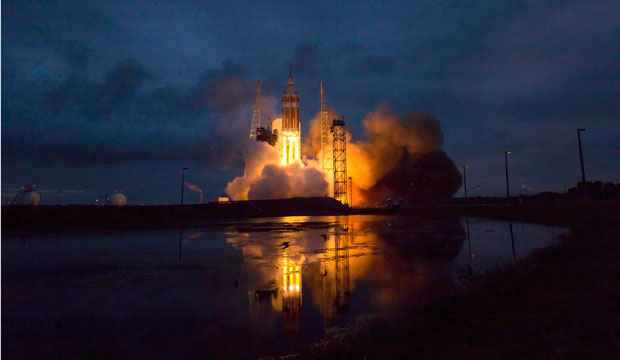 The rocket with NASA's Orion spacecraft mounted on top lifts off from Cape Canaveral Air Force Station on December 5, 2014.