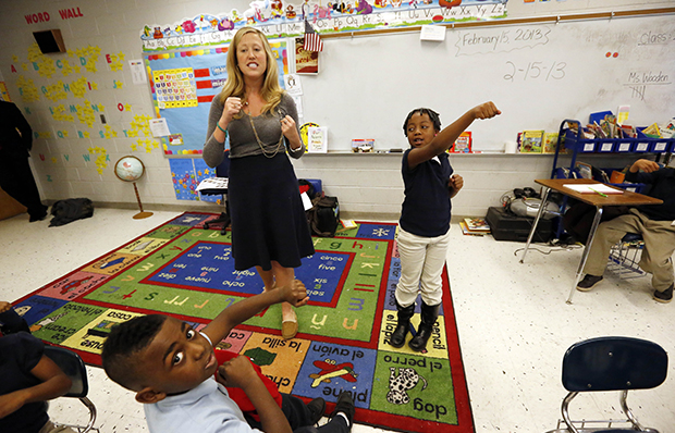Myrtle Hall IV Elementary School teacher Gabrielle Wooden, left, and Camilyn Anderson, 7, lead their first-grade class in a live-action Spanish class in Clarksdale, Mississippi, February 15, 2013.