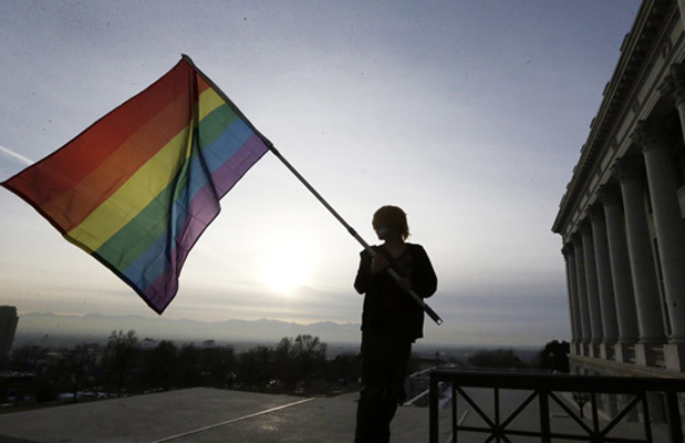 Corbin Aoyagi, a supporter of gay marriage, waves his flag during a rally at the Utah State Capitol, Tuesday, January 28, 2014.
