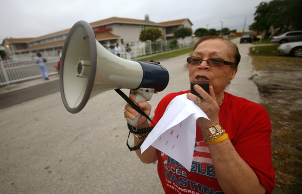 Lena Rahming walks through Boynton Beach, Florida, urging people to vote on Tuesday, November 4, 2008.