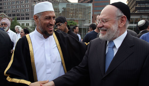 Sheikh Imam Mohammed Shchata and Rabbi Albert Gabbi talk during a public assembly for religious tolerance in Philadelphia.