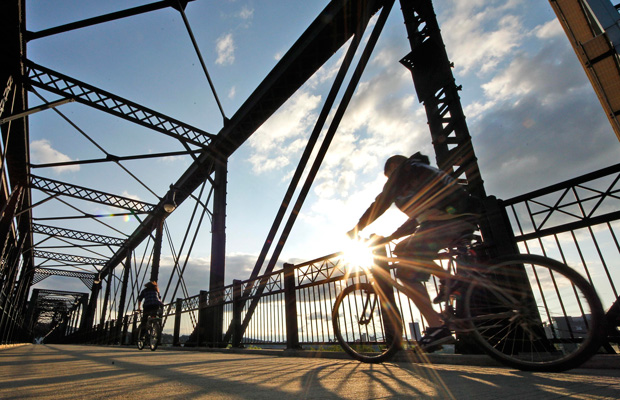 Cyclists cross the Hot Metal Bridge over the Monongahela River during the evening rush hour.