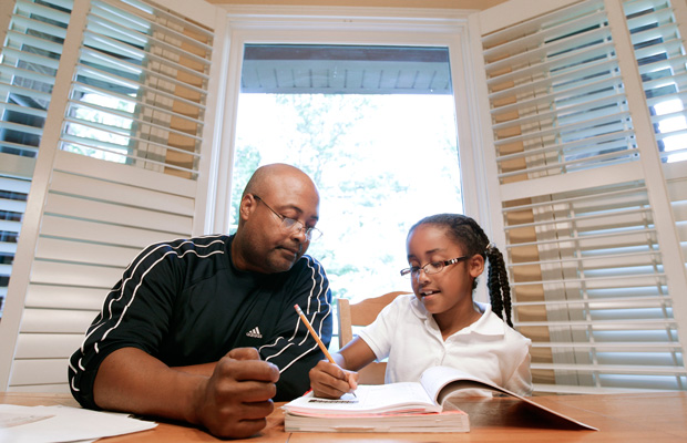 Roger Witherspoon helps his daughter with her homework in Nashville, Tennessee.