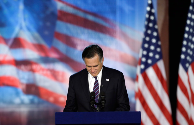 Former Massachusetts Gov. Mitt Romney (R) pauses as he addresses supporters during his election night rally, November 7, 2012, in Boston.