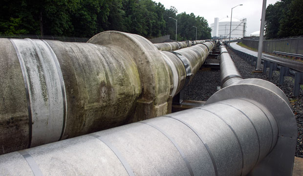 Transfer pipes carry liquefied natural gas to and from a holding tank at an LNG terminal in Lusby, Maryland.