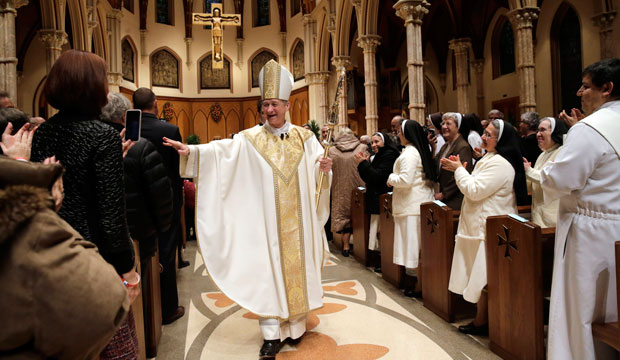 Archbishop Blase Cupich walks down the aisle after his installation Mass at Chicago's Holy Name Cathedral on November 18, 2014.